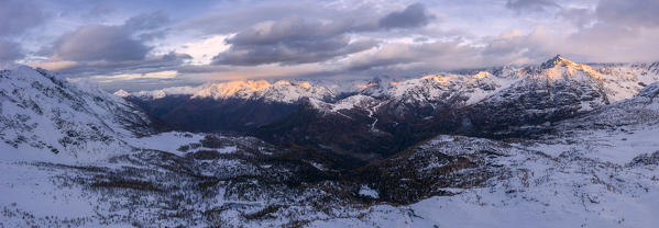 Panoramic of the snowy peaks of Sasso Moro and Monte Disgrazia at dawn, Malenco Valley, Sondrio province, Valtellina, Lombardy, Italy