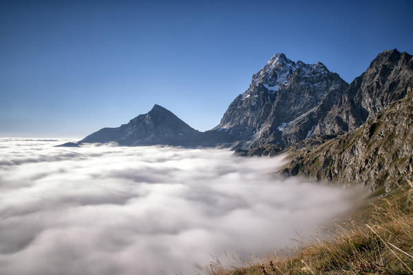 Low Clouds around Monviso. Cozian Alps, Piedmont, Italy Europe