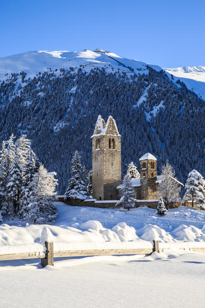 The church of San Gian in winter. Celerina, Engadine, Canton of Grisons, Switzerland Europe