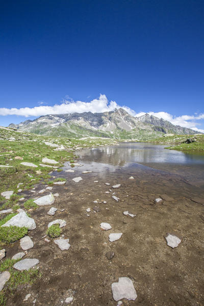 Shallow waters of Lake Bianco to Pian dei Cavalli. High Spluga Valley. Valtellina. Lombardy. Italy. Europe