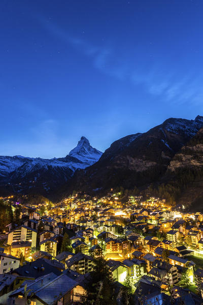 View of Zermat at dusk with Matterhorn in the background. Canton of Valais, Switzerland Europe