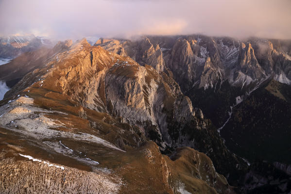 Aerial view of the group Catinaccio Rosengarter at sunset. Sciliar Natural Park. Val di Fassa. Dolomites. Italy Europe