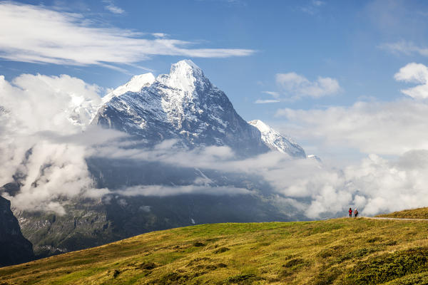 Hikers on the way to Mount Eiger First Grindelwald Bernese Oberland Canton of Berne Switzerland Europe