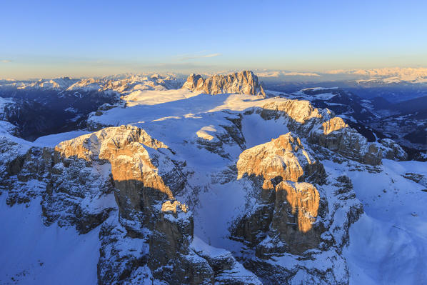 Aerial view of Sassolungo and Grohmann peak at sunset. Dolomites Sella Group Trentino Alto Adige Italy Europe