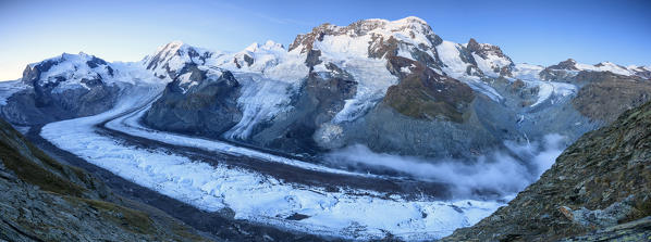 Panoramic view of Mount Rosa Massif and its glacier at dusk Zermatt Pennine Alps Canton of Valais Switzerland Europe