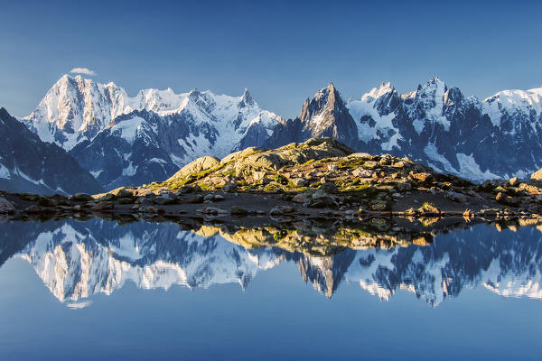 Snowy peaks of Dent Du Geant and Grandes Jorasses are reflected in Lac Blanc Haute Savoie France Europe