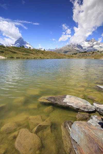 Lake Leisee frames the Matterhorn and the high peaks in the background in summer Zermatt Canton of Valais Switzerland Europe