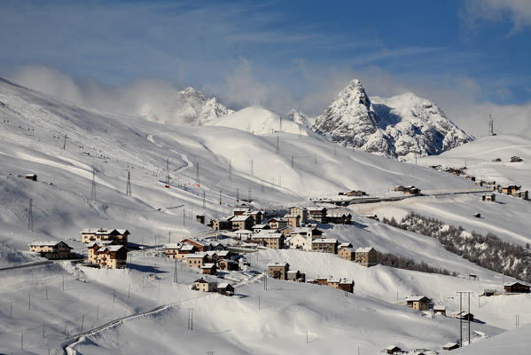 View of Trepalle village the highest town in Italy in winter with the tops of Livigno Valley windswept. Valtellina. Lombardy Italy Europe