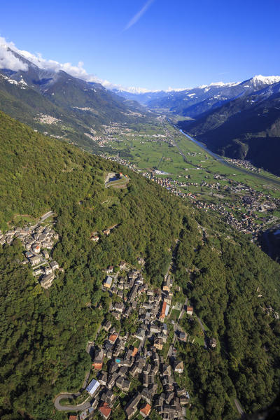 Aerial view of the village of Biolo surrounded by woods at fall Sondrio Province Valtellina Lombardy Italy Europe