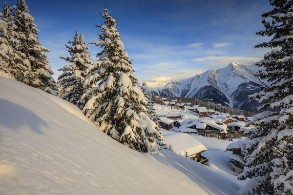 Sunset frames the mountain huts and woods covered with snow Bettmeralp district of Raron canton of Valais Switzerland Europe