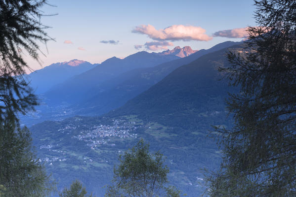 Top view of the village of Teglio framed by the rocky peaks of the Rhaetian Alps at dawn Valtellina Lombardy Italy Europe
