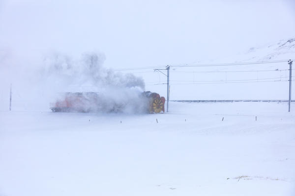 Snowplow of Bernina Express train during a snow storm, canton of Graubünden, Engadin Valley, Switzerland