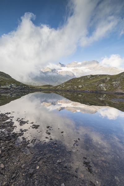 Peaks Arlas, Cambrena, Caral reflected in lake, Bernina Pass, Poschiavo Valley, canton of Graubünden, Engadine, Switzerland