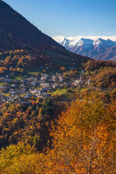 The bright colors of the  autumn painting the landscape surrounding the small village of Sacco Orobie Alps, Valtellina, Sondrio, Lombardy, Italy Europe