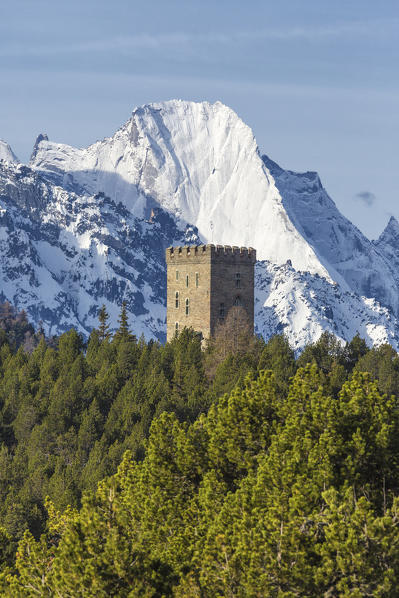 The Belvedere Tower frames the snowy peaks and Peak Badile on a spring day Maloja Pass Canton of Graubunden Switzerland