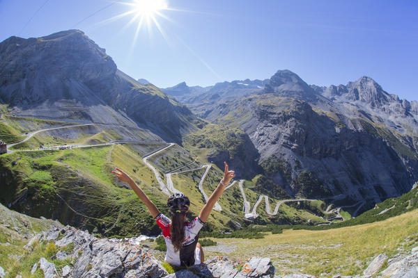 cyclism in the hairpins of stelvio pass during summer bormio
