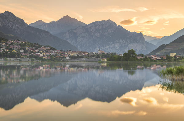 Sunrise on Coltignone mount and Lecco mountains reflected on lake Annone, Lecco province, Brianza, Lombardy, Italy, Europe