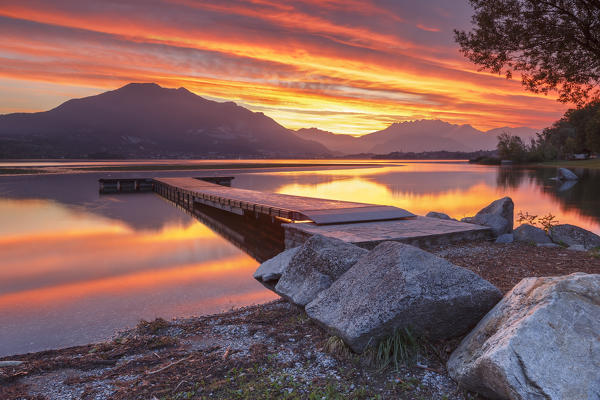 Lecco mountains on fire, sunrise on lake Pusiano, Como and Lecco province, Brianza, Lombardy, Italy, Europe