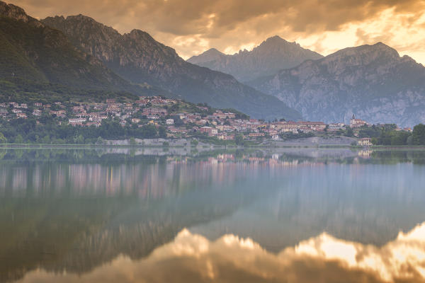 Fire sunrise on Lecco mountains, lake Annone, Lecco province, Brianza, Lombardy, Italy, Europe