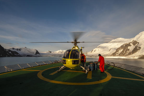 Antarctica, South Shetlands Islands, Livingston Island, Helicopter landing on Antarctic Dream ship.